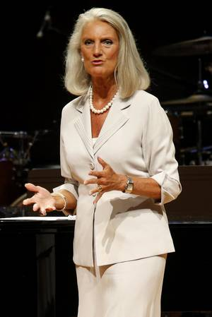 Photo - Evangelist Anne Graham Lotz, above left, daughter of evangelist Billy Graham, speaks, and gospel recording artist Sandi Patty, above right, performs Tuesday during the Church of God Convention at Crossings Community Church, 14600 N Portland, in Oklahoma City.  Photos by Bryan Terry, The Oklahoman <strong>BRYAN TERRY</strong>