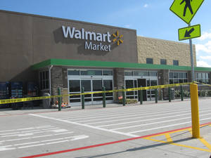 Photo - The Walmart Market, 7520 E Reno Ave., is where a man was shot and killed after holding a 2-year-old girl hostage, Midwest City Assistant Police Chief Sid Porter said. The store was closed for several hours while officers processed the scene. Photo by Matt Dinger, The Oklahoman <strong></strong>