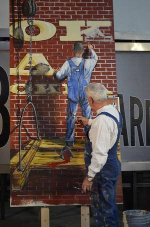 Photo - In this March 1, 2014 photo provided by the Billboard Museum Association, Inc., muralist Bob Palmer is shown at Superior Neon in Oklahoma City. Palmer was one of three artists who showcased his work at a recent workshop and demonstration to draw support for a proposed museum dedicated to billboards and vintage signs along Route 66 in Oklahoma. (AP Photo/Billboard Museum Association)