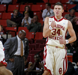 Photo - OU's Cade Davis reacts during the NCAA basketball game between the University of Oklahoma and Texas Southern at the Lloyd Noble Center in Norman, Okla., on Thursday, Nov., 18, 2010.  Photo by Bryan Terry, The Oklahoman ORG XMIT: KOD