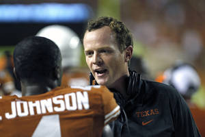 Photo - Texas offensive coordinator Major Applewhite talks with defensive back Daje Johnson during the third quarter of an NCAA college football game against New Mexico State, Saturday Aug. 31, 2013, in Austin, Texas. (AP Photo/Michael Thomas)