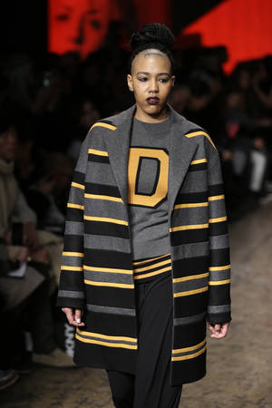 Photo - The Fall 2014 DKNY collection is modeled during Fashion Week in New York, Sunday, Feb. 9, 2014. (AP Photo/Seth Wenig)