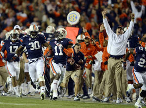 Photo - Auburn cornerback Chris Davis (11) returns a missed field-goal attempt more than 100 yards for a touchdown on the final play of an NCAA college football game against Alabama in Auburn, Ala., Saturday, Nov. 30, 2013. (AP Photo/Montgomery Advertiser, Amanda Sowards)