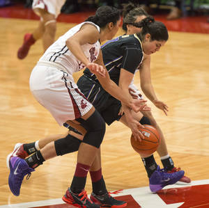 Photo - Washington guard Kelsey Plum, center, controls a loose ball contested by Washington State center Shalie Dheensaw, left, and guard Dawnyelle Awa during the first half of an NCAA college basketball game Tuesday, Jan. 7, 2014, at Beasley Coliseum in Pullman, Wash. (AP Photo/Moscow-Pullman Daily News, Dean Hare)