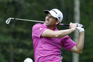 Photo - Sergio Garcia, form Spain, watches his tee shot on the eighth hole during the second round of the Deutsche Bank Championship golf tournament in Norton, Mass., Saturday, Aug. 31, 2013. (AP Photo/Stew Milne)