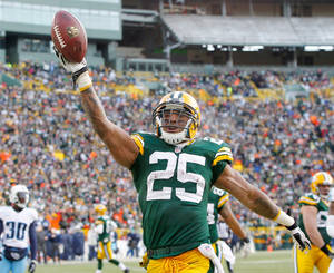Photo - Green Bay Packers' Ryan Grant reacts as he runs for a touchdown during the second half of an NFL football game against the Tennessee Titans Sunday, Dec. 23, 2012, in Green Bay, Wis. The Packers won 55-7. (AP Photo/Mike Roemer)