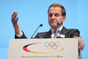 Photo - Newly elected DOSB President Alfons Hoermann, President of the German Ski Federation (DSV), speaks to the delegates at the members' meeting of the German Olympic Sports Confederation (DOSB) in Wiesbaden, Germany, Saturday Dec. 7,2013. Germany's national sports body appointed Alfons Hoermann as president on Saturday, filling the position vacated by International Olympic Committee president Thomas Bach.  The 53-year-old Hoermann, since 2005 the head of the German skiing federation (DSV), received 434 votes from 459 delegates for a one-year term in charge of the German Olympic Sports Confederation (DOSB). A vote for another four-year term will take place in December 2014.  (AP Photo/dpa, Arne Dedert)