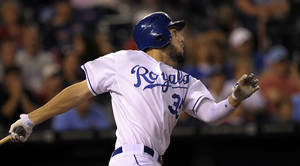 photo -   Kansas City Royals first baseman Eric Hosmer hits a single and drives in two runs, to bring the Royals within one run of the Twins in the seventh inning during the second baseball game of a doubleheader, Saturday, Sept. 1, 2012, in Kansas City, Mo. (AP Photo/Reed Hoffmann)