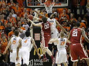 Photo - Oklahoma State's Markel Brown (22) defends against Oklahoma's Ryan Spangler (00) during the men's Bedlam college game between Oklahoma and Oklahoma State at Gallagher-Iba Arena in Stillwater, Okla., Saturday, Feb. 15, 2014. Photo by Sarah Phipps, The Oklahoman