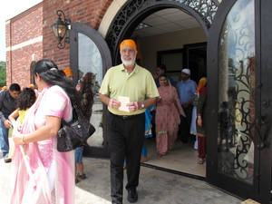 Photo - Members of the metro Sikh faith community leave their new gurdwara after a special celebration and service held for the building's grand opening on May 19 at 4525 NW 16. Photo by Carla Hinton <strong></strong>