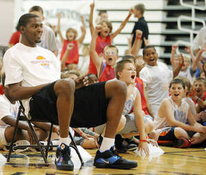 Photo - Children react after Kevin Durant made a half-court shot while sitting during his camp at Heritage Hall. Photo by Nate Billings, The Oklahoman