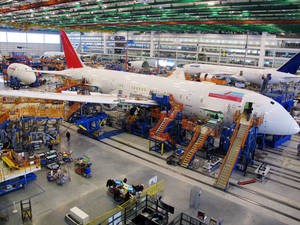 Photo - FILE - In this Thursday, Dec. 19, 2013, file photo, workers assemble Boeing 787 Dreamliners in the company's massive assembly plant in North Charleston, S.C.  Boeing reports quarterly financial results on Wednesday, Jan. 29, 2014. (AP Photo/Bruce Smith, File)