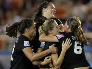 Photo -   Kealia Ohai, ,center, of the United States celebrates with teammates after scoring a goal against Germany during their final match of the U20 women's World Cup in Tokyo, Saturday, Sept. 8, 2012. (AP Photo/Itsuo Inouye)