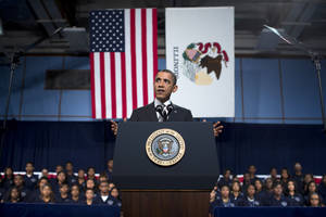 photo - President Barack Obama gestures as he speaks at Hyde Park Academy on Friday, Feb. 15, 2013, in Chicago. Obama is traveling to promote the economic and educational plan he laid out in his State of the Union address.  (AP Photo/Evan Vucci)