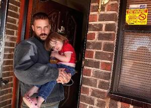 photo - John Jettee, 34, holds Trinity, 2, on the front porch of their home on Cinderella in southeast Oklahoma City. Jettee, his wife and family live in a neighborhood with one of the highest homicide rates in Oklahoma City. Photo taken Thursday, Jan. 6, 2011. Photo by Jim Beckel, The Oklahoman