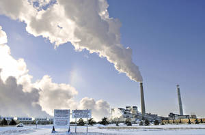 Photo - File-This Dec. 5, 2013, file photo shows the Sherco power plant in Becker, Minn. Minnesota, which already successfully lowered carbon emissions and capitalized on renewable energy sources, must cut carbon dioxide emissions by nearly 41 percent over the next 15 years as part of a sweeping plan President Barack Obama announced Monday, June 2, 2014, to reduce pollution from power plants. (AP Photo/St. Cloud Times, Jason Wachter, File)