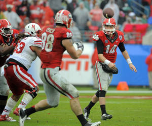 Photo - Georgia quarterback Hutson Mason (14) throws a pass to tight end Arthur Lynch (88) during the first half of the Gator Bowl NCAA college football game against Nebraska, Wednesday, Jan. 1, 2014, in Jacksonville, Fla. (AP Photo/Stephen B. Morton)
