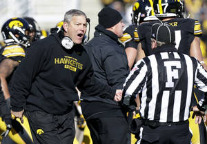 Photo - Iowa head coach Kirk Ferentz reacts to a call against his team during the first half of an NCAA college football game against Michigan, Saturday, Nov. 23, 2013, in Iowa City, Iowa. (AP Photo/Charlie Neibergall)