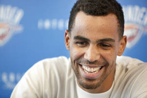 Photo - OKLAHOMA CITY THUNDER NBA BASKETBALL TEAM: Oklahoma City's Thabo Sefolosha (2) speaks during a press conference at the Integris Health Thunder Development Center in Oklahoma City,  Saturday, June 23, 2012. Photo by Sarah Phipps, The Oklahoman