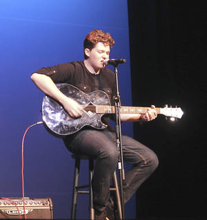"Photo - Jonathan O'Neal is the winner of the 2013 Edmond's Got Talent competition. O'Neal, an Edmond North High School senior, sang an original arrangement of ""Billy Jean"" by Michael Jackson."