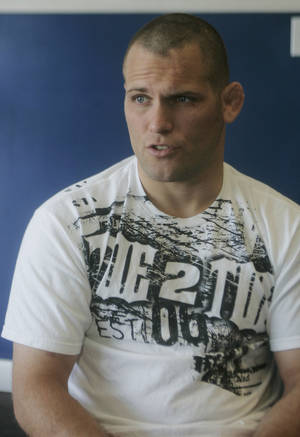Photo - Matt Grice, shown here in 2009, remains in critical condition after suffering a head injury in a crash Sunday. Grice is an Oklahoma City police officer and Ultimate Fighting Championship fighter. AP PHOTO <strong> - AP</strong>