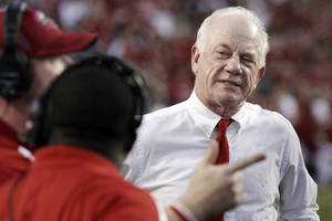 photo -   Jacksonville State coach Jack Crowe walks the sideline during the second quarter of an NCAA college football game against Arkansas in Fayetteville, Ark., Saturday, Sept. 1, 2012. (AP Photo/Danny Johnston)