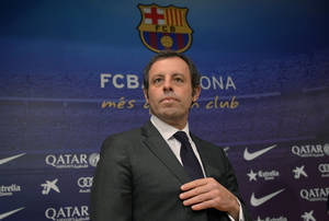 Photo - FC Barcelona's president Sandro Rosell, attends a press conference at the Camp Nou stadium in Barcelona, Spain, Thursday, Jan 23, 2014. Sandro Rosell is stepping down as president of Barcelona a day after a judge agreed to hear a lawsuit accusing him of allegedly hiding the cost of the transfer of Brazil striker Neymar.Rosell says he is resigning after an emergency meeting with Barcelona's board of directors on Thursday. Rosell says vice president Josep Bartomeu will take his place as president and finish the term that expires in 2016. Elected in 2010 to replace outgoing president Joan Laporta, Rosell said last April he planned to run for re-election in 2016. (AP Photo/Manu Fernandez)