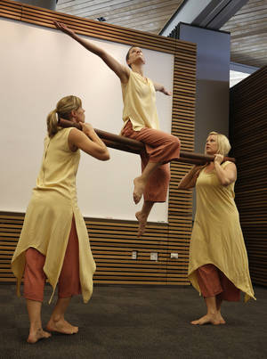 Photo - Amy Nevius, Emily Dawson and Michelle Moeller, with Perpetual Motion dance company, perform at the  Patience S. Latting Northwest Library in Oklahoma City.  Photo by Garett Fisbeck, The Oklahoman <strong>Garett Fisbeck - Garett Fisbeck</strong>