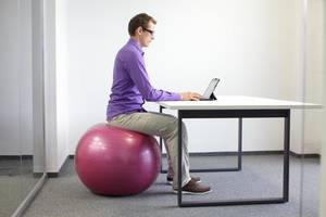 Photo -  Some office workers have substituted a stability ball for their chair.   <strong></strong>