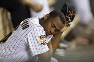 Photo -   Houston Astros relief pitcher Enerio Del Rosario sits on the bench after being pulled during the eighth inning of a baseball game against the Philadelphia Phillies on Friday, Sept. 14, 2012, in Houston. (AP Photo/David J. Phillip)