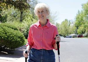 Photo -   In this photo taken on April 23, 2012, Elaine Vlieger, 79, walks near her home near Denver, Colo. Vlieger is making some concessions to her early stage Alzheimer's, but isn't ready to give up either her home or her independence. She stays active with yard work and daily walks. (AP Photo/Ed Andrieski)