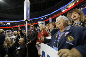 photo - Oklahoma Gov. Mary Fallin and the state delegates react Tuesday as Mitt Romney is nominated as the GOP presidential candidate at the Republican National Convention in Tampa, Fla. AP PHOTO
