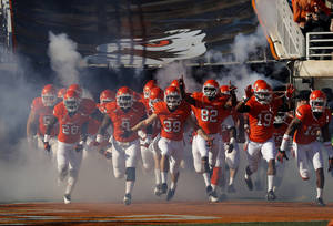 photo - Oklahoma State runs on to the field before a college football game between Oklahoma State University and the Texas Tech University (TTU) at Boone Pickens Stadium in Stillwater, Okla., Saturday, Nov. 17, 2012. Photo by Sarah Phipps, The Oklahoman