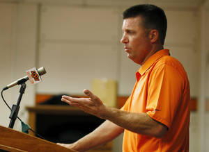 Photo - COLLEGE FOOTBALL: Head coach Mike Gundy speaks during media day for the Oklahoma State University football team inside OSU's Gallagher-Iba Arena, Saturday, Aug. 3, 2013. Photo by Nate Billings, The Oklahoman