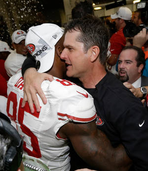 photo - San Francisco 49ers head coach Jim Harbaugh hugs Vernon Davis after the NFL football NFC Championship game against the Atlanta Falcons Sunday, Jan. 20, 2013, in Atlanta. The 49ers won 28-24 to advance to Super Bowl XLVII. (AP Photo/Dave Martin)