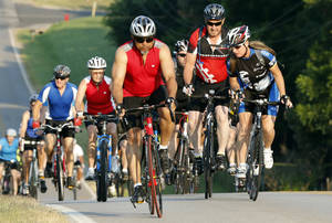 Photo -  Riders head east on Robinson Street during last year's Norman Conquest bicycle ride that benefits the J.D. McCarty Center. PHOTO BY STEVE SISNEY, THE OKLAHOMAN ARCHIVES  <strong>STEVE SISNEY -   </strong>