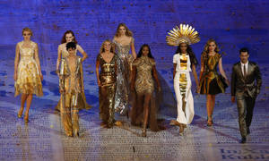 "Photo -   FILE - This Sunday Aug. 12, 2012 file photo shows models, from left, Lily Cole, Karen Elson, Stella Tennant, Kate Moss, Lily Donaldson, Naomi Campbell, Jourdan Dunn and Georgia May Jagger walking with a male model during the Closing Ceremony at the 2012 Summer Olympics in London. Models had their moment at the closing ceremony of the London Olympics, with the likes of Kate Moss and Naomi Campbell bringing gold ballgowns, high heels and glamour to the stadium that had been home to sneakers and sweat. The unusual moment seemed to stump even the NBC announcers, who identified Campbell and Moss and otherwise stayed silent for much of the tribute set to David Bowie's ""Fashion."" (AP Photo/Alastair Grant)"