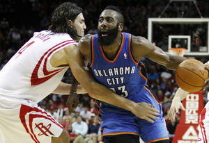 Photo - Houston Rockets forward Luis Scola (4) guards Oklahoma City Thunder guard James Harden (13) during the second half of an NBA basketball game, Saturday, Jan. 7, 2012, in Houston. The Thunder won 98-95. (AP Photo/Eric Kayne) ORG XMIT: TXELK113
