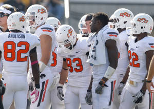 Photo - Oklahoma State's Justin Blackmon (81) huddles up with the offensive without his helmet during a college football game between the Oklahoma State University Cowboys (OSU) and the University of Missouri Tigers (Mizzou) at Faurot Field in Columbia, Mo., Saturday, Oct. 22, 2011. Photo by Sarah Phipps, The Oklahoman