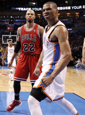 photo - Oklahoma City's Russell Westbrook (0) celebrates a dunk in front of Chicago's Taj Gibson (22) during the NBA basketball game between the Chicago Bulls and the Oklahoma City Thunder at Chesapeake Energy Arena in Oklahoma City, Sunday, April 1, 2012. Photo by Sarah Phipps, The Oklahoman