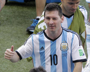 Photo - Argentina's Lionel Messi winks as he leaves the pitch after the group F World Cup soccer match between Argentina and Iran at the Mineirao Stadium in Belo Horizonte, Brazil, Saturday, June 21, 2014. Lionel Messi scored a superb goal in stoppage time to give Argentina a 1-0 victory over Iran.(AP Photo/Sergei Grits)