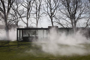 "Photo - This Saturday, April 19, 2014 photo provided by courtesy of The Glass House shows Tokyo-based artist, Fujiko Nakaya's latest ""fog installation,"" meant to conceal the visible while accentuating usually invisible forces like wind. Like the glass structure itself, ""Fujiko Nakaya: Veil"" plays on the visible and invisible, transparent and opaque, permanent and ephemeral.  The installation, about an hour's train ride north of New York City, is open to the public from May 1 to November 30, 2014. (AP Photo/The Glass House, Copyright Richard Barnes 2014) **MANDATORY CREDIT**"