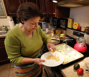 Photo - Sherrel Jones shows how she makes Oklahoma-shaped chips from corn and flour tortillas. <strong></strong>