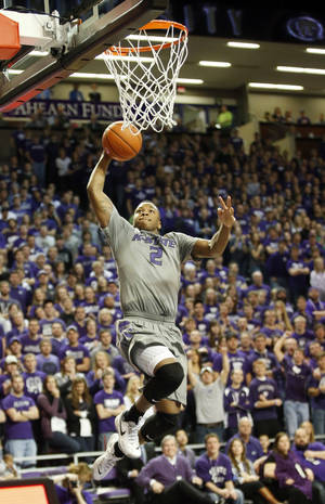Photo - Kansas State  guard Marcus Foster (2)  dunks against Texas during the second half of an NCAA college basketball game Saturday, Feb. 8, 2014, in Manhattan, Kan. (AP Photo/The Wichita Eagle, Bo Rader) LOCAL TV OUT; MAGS OUT; LOCAL RADIO OUT; LOCAL INTERNET OUT