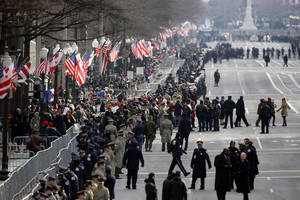 photo - Security lines Pennsylvania Avenue in Washington, Monday, Jan. 21, 2013, prior to the start of the 57th Presidential Inaugural Parade which will take place following President Barack Obama's ceremonial swearing-in on Capitol Hill. (AP Photo/Alex Brandon)