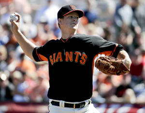 Photo - San Francisco Giants starting pitcher Matt Cain throws to the Chicago Cubs during the first inning of a spring exhibition baseball game in Scottsdale, Ariz., Monday, March 10, 2014. (AP Photo/Chris Carlson)