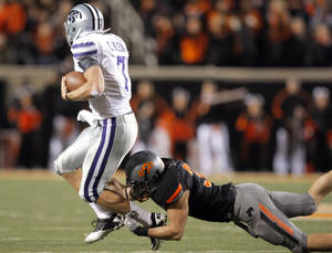 photo - Oklahoma State's Alex Elkins (37) grabs Collin Klein (7) by the ankles during a college football game between the Oklahoma State University Cowboys (OSU) and the Kansas State University Wildcats (KSU) at Boone Pickens Stadium in Stillwater, Okla., Saturday, Nov. 5, 2011.  Photo by Sarah Phipps, The Oklahoman