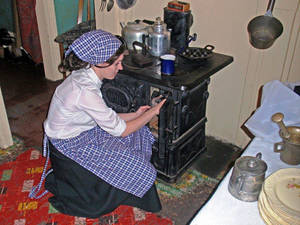 Photo -  An interpreter at the Tenement Museum in New York City shows visitors what life was like for early immigrants to the United States. Photo courtesy of Victor Block.
