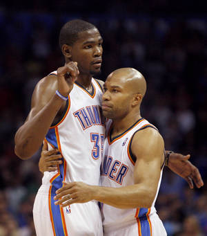 Photo - Oklahoma City's Derek Fisher (37) celebrates with Oklahoma City Thunder's Kevin Durant (35) during the NBA basketball game between the Miami Heat and the Oklahoma City Thunder at Chesapeake Energy Arena in Oklahoma City, Sunday, March 25, 2012. Photo by Sarah Phipps The Oklahoman