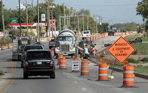 Photo - Traffic on Classen Boulevard near Imhoff Road in Norman narrows to two lanes as work continues on improving the intersection and widening a one-mile stretch of Classen between Imhoff and Constitution Avenue.  PHOTO BY STEVE SISNEY, THE OKLAHOMAN